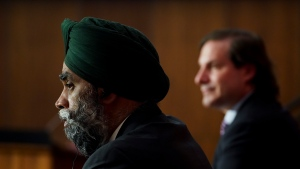 Immigration Minister Marco Mendicino, right, and Harjit Sajjan, Minister of National Defence hold a press conference in Ottawa on Friday, July 23, 2021. The federal government says it will fast-track the resettlement of Afghans who previously worked with the Canadian military and embassy and are now at risk from the Taliban. THE CANADIAN PRESS/Sean Kilpatrick