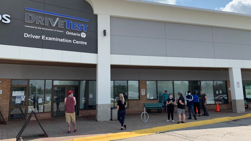 People wait outside of Kitchener's Drive Test centre (Colton Wiens / CTV Kitchener)