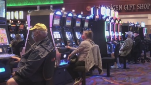 Gamblers don their masks to sit at slot machines at Casino Rama in Rama, Ont. on Thurs. July 29, 2021. (Siobhan Morris/CTV News)