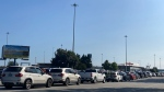 Vehicles are seen lined up at the Tsawwassen ferry terminal on Thursday, July 29, 2021. BC Ferries said vehicle space was sold out before 4 p.m. as passengers flocked to Vancouver Island for the B.C. Day long weekend.