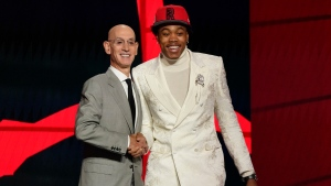 Scottie Barnes, right, poses for a photo with NBA Commissioner Adam Silver after being selected fourth overall by the Toronto Raptors during the first round of the NBA basketball draft, Thursday, July 29, 2021, in New York. (AP Photo/Corey Sipkin)