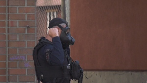 At one point, officers donned gas masks and told reporters and the public to move back as they may use weapons capable of shooting a gas grenade: (CTV News)