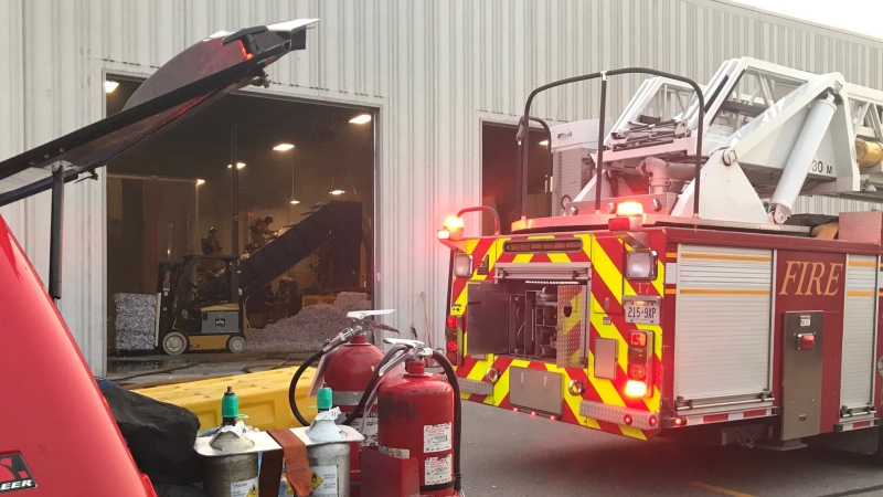 Firefighters work at the scene of a warehouse fire in London, Ont. on Thursday, July 29, 2021. (Sean Irvine / CTV News)