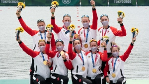 Canada's Lisa Roman, Kasia Gruchalla-Wesierski, Christine Roper, Andrea Proske, Susanne Grainger, Madison Mailey, Sydney Payne, Avalon Wasteneys and Kristen Kit celebrate on the podium after winning the gold medal in women's eight rowing competition at the Tokyo Olympics, Friday, July 30, 2021 in Tokyo, Japan. THE CANADIAN PRESS/Adrian Wyld