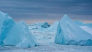 Warmer coastal water melts the Greenland ice sheet around the edges, breaking off massive icebergs that contribute to sea level rise. (Ulrik Pedersen/NurPhoto/Getty Images)