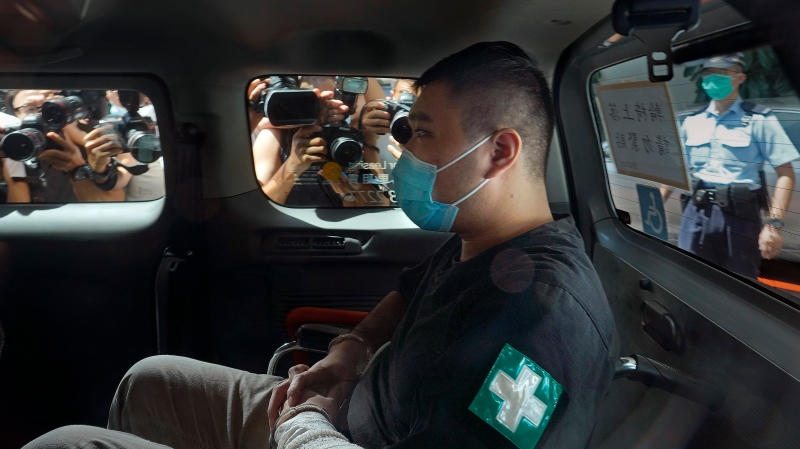 In this July 6, 2020, file photo, Tong Ying-kit arrives at a court in a police van in Hong Kong. (AP Photo/Vincent Yu, File)