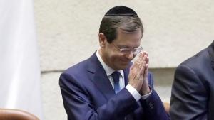 Israel's President-elect Isaac Herzog gestures during his sworn in ceremony in the Knesset in Jerusalem, Wednesday, July 7, 2021. (AP Photo/Sebastian Scheiner)