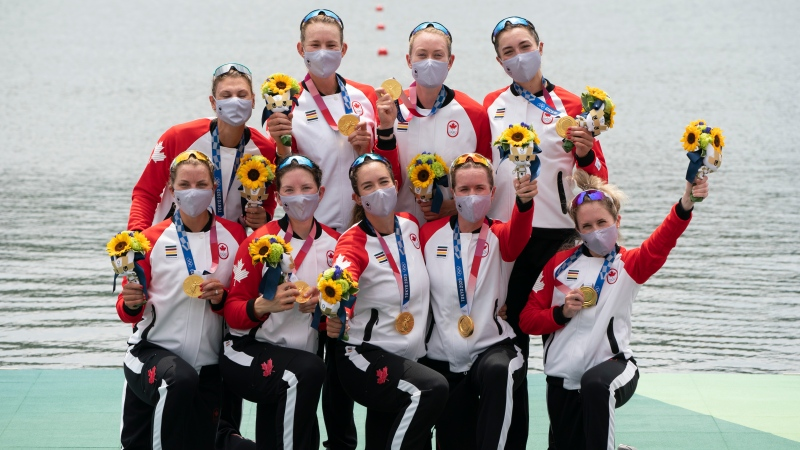 Canada's Lisa Roman, Kasia Gruchalla-Wesierski, Christine Roper, Andrea Proske, Susanne Grainger, Madison Mailey, Sydney Payne, Avalon Wasteneys and Kristen Kit celebrate on the podium after winning the gold medal in women's eight rowing competition at the Tokyo Olympics, July 30, 2021 in Japan. THE CANADIAN PRESS/Adrian Wyld