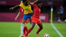 Canada's Deanne Rose and Brazil's Bruna Benites battle for the ball during a women's quarterfinal soccer match at the 2020 Summer Olympics, July 30, 2021, in Rifu, Japan. (AP Photo/Andre Penner)
