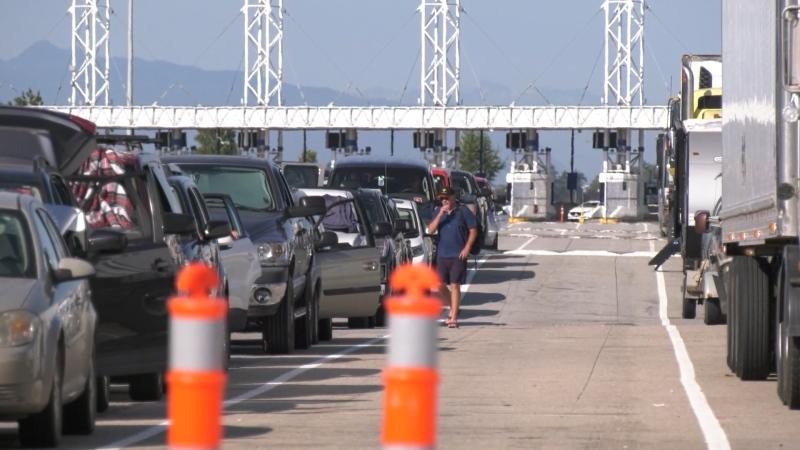 Passengers wait to board a ferry at Tsawwassen ferry terminal.