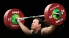 In this April 9, 2018, file photo, New Zealand's Laurel Hubbard lifts in the snatch of the women's 90kg weightlifting final at the 2018 Commonwealth Games on the Gold Coast, Australia. Hubbard, a transgender woman, is competing in weightlifting for New Zealand (AP Photo/Mark Schiefelbein, File)