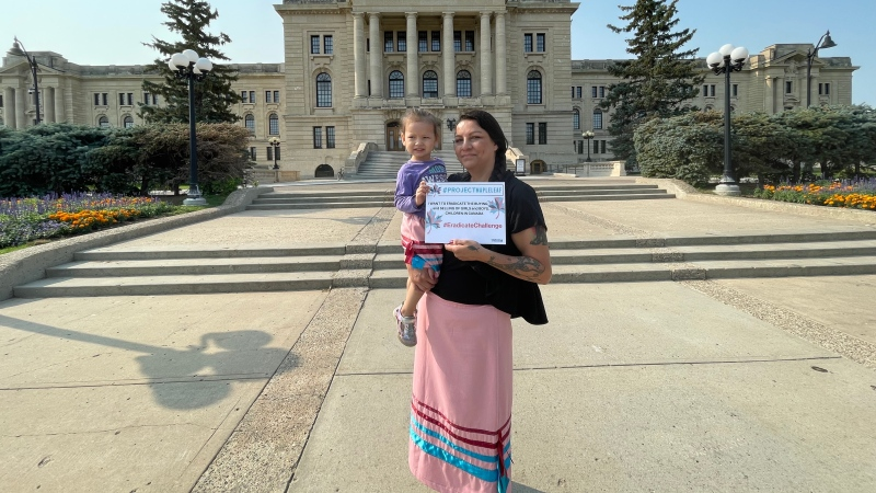 Beatrice Wallace, a human trafficking survivor and ambassador for Project Maple Leaf, stands on the steps of the Saskatchewan Legislative Building with her granddaughter. (Marc Smith/CTV News)