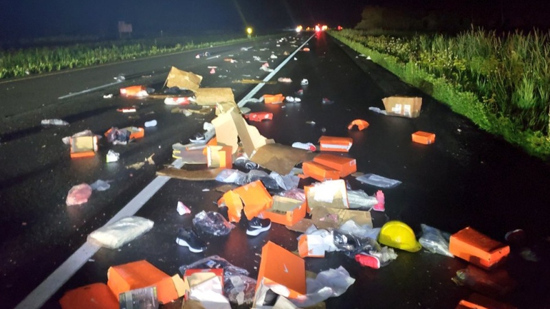 A two vehicle crash on Highway 401 Friday left a trail of Nike debris. (Photo courtesy: Twitter/OPP_ER)