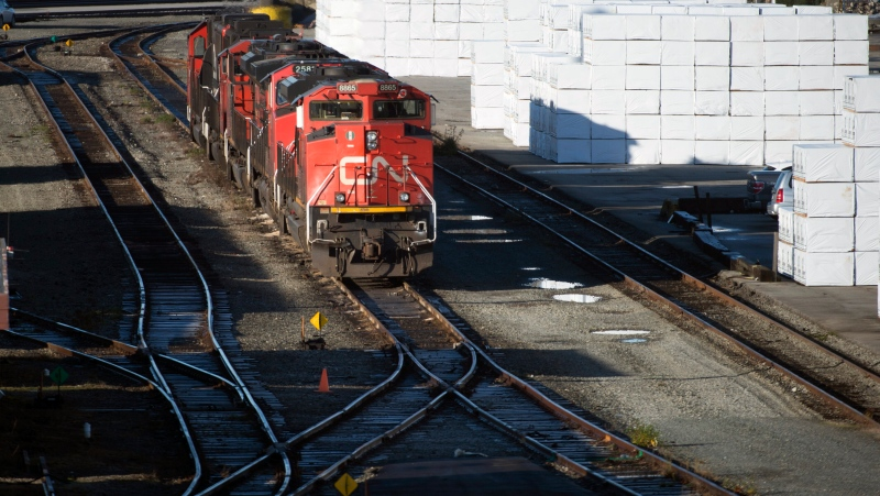 In this in this Nov. 20, 2019, file photo, a CN train Mclean Rail Yard in North Vancouver, British Columbia, is pictured. (Jonathan Hayward/The Canadian Press via AP, File)