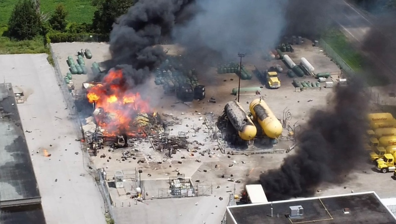 Flames continue to burn after a propane explosion in the city's south end on Friday July 30, 2021 (Courtesy Kyle Schienbein/Photographer)