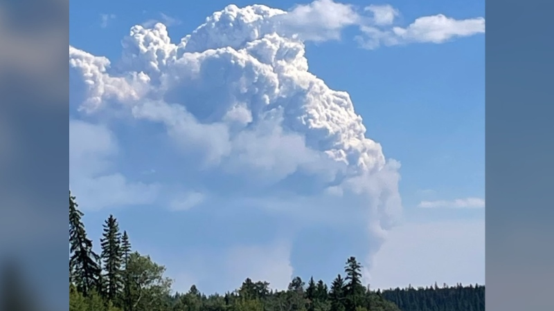 Smoke visible from a planned burn of the Flat Lake wildfire on July 29, 2021. (BC Wildfire Service/Twitter)