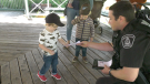 Brockville Police Service community safety officer Greg Francis hands out a Good Deed Citation to Theo. (Nate Vandermeer/CTV News Ottawa)