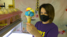 Melissa McCoo of Cowan's Dairy in Brockville holding up a cone with Super Heroes Ice Cream. (Nate Vandermeer/CTV News Ottawa)