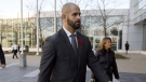 FILE - Michael Theriault arrive at the Durham Region Courthouse in Oshawa, Ont., ahead of Dafonte MIller's testimony, on Wednesday, Nov. 6, 2019. THE CANADIAN PRESS/Cole Burston