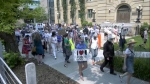 Several dozen people turned out for a rally against the lifting of COVID-19 restrictions at the McDougall Centre.