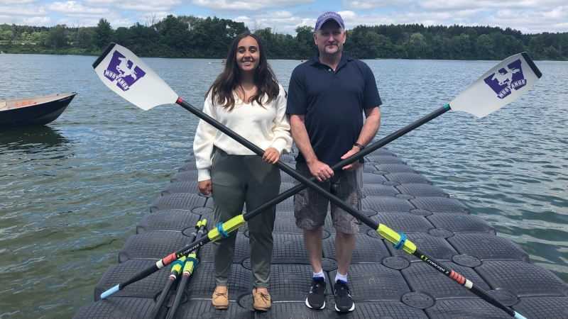 Erin Alizadeh, manager at the London Western Rowing Club, and coach Bob Ward pose at Fanshawe Lake in London, Ont. on Friday, July 30, 2021. (Jordyn Read / CTV News)