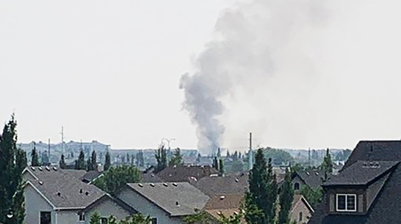 A structure fire was burning Friday afternoon in the area around Auburn Bay, in Calgary. (Courtesy: Twitter)