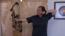 Marianne Bell, co-founder of Toxon Technologies, shows off a new tool to help archers. (Colton Wiens/CTV Kitchener)
