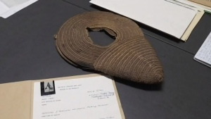 """""""We found the 'hat' yesterday, and we just thought it was a very unusual object, and even though all of our documentation says hat, we just were like it doesn't necessarily look like a hat,"""" said Holly Gallant, the collections manager at Fredericton Region Museum."""