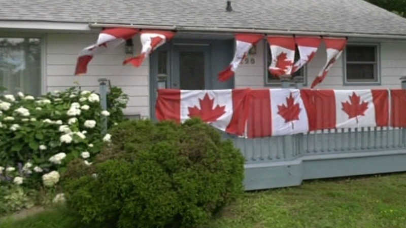 North Bay woman hangs flags for each Olympic meda