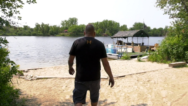 Daryl Sabourin said he grew up swimming at this small beach on the Crown land shores of St. Malo Lake as a child in the 70s. (Source: Danton Unger/ CTV News Winnipeg)