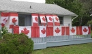 It doesn't matter if it's gold, silver or bronze, each time Canada wins a medal at the 2020 Tokyo Olympics, Sue Childs-Furlong adds a Canadian Flag to her front porch. (Jaime McKee/CTV News)