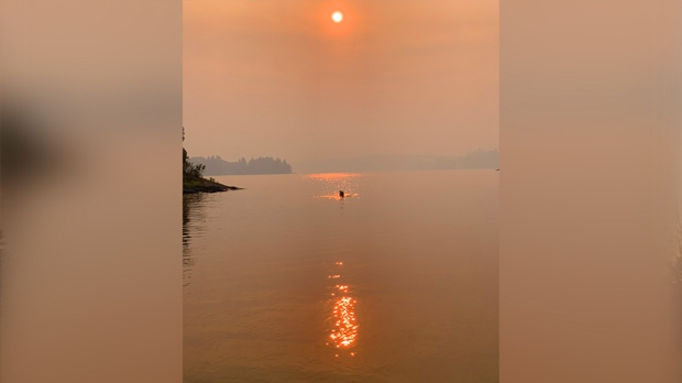 Swimming in the smoke at Lake of the Woods. Photo by Tod Hughes.