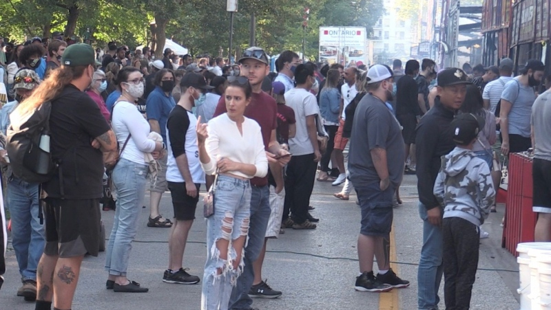 People wait in food lines at London, Ont.'s Ribfest on Friday, July 30, 2021. (Sean Irvine / CTV News)