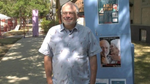 """Pictured is Gerald Williams in front of a poster for his play """"How I Murdered My Mother."""""""