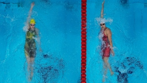 Kylie Masse, of Canada, right, swims to victory ahead of Kaylee Mckeown, of Australia, in a women's 200m backstroke semifinal at the 2020 Summer Olympics, Friday, July 30, 2021, in Tokyo, Japan. (AP Photo/Jeff Roberson)