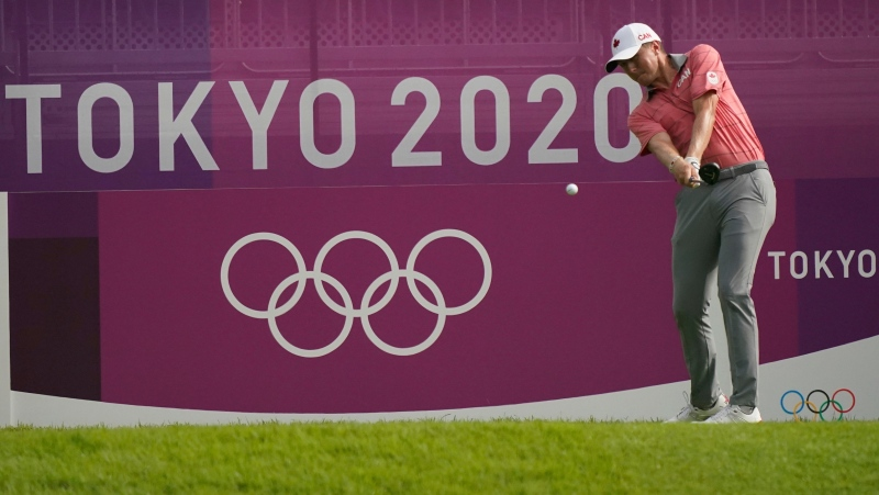 Mackenzie Hughes of Canada hits a tee shot on the first hole during the second round of the men's golf event at the 2020 Summer Olympics on Thursday, July 29, 2021, at the Kasumigaseki Country Club in Kawagoe, Japan. (AP Photo/Matt York)