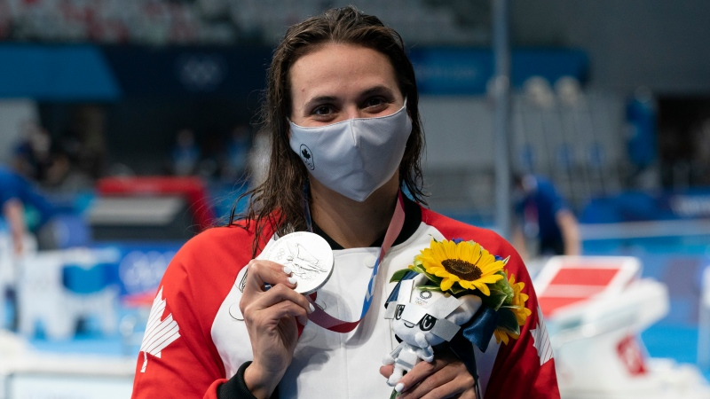 Canadian swimmer Kylie Masse, from LaSalle, Ont. holds up her silver medal in the women's 200m backstroke at the Tokyo Olympics, Saturday, July 31, 2021 in Tokyo, Japan. THE CANADIAN PRESS/Adrian Wyld