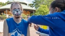Louis-Philippe Pichette gets a COVID-19 vaccination at a clinic at LaRonde amusement park Friday, July 30, 2021 in Montreal as the Quebec government continues its efforts to get more people vaccinated. THE CANADIAN PRESS/Ryan Remiorz