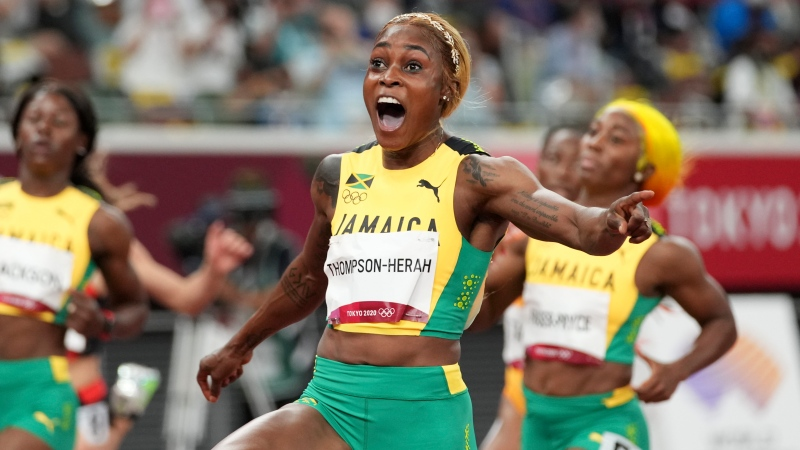 Elaine Thompson-Herah of Jamaica reacts as she crosses the finish line to win the women's 100-metre final at the 2020 Summer Olympics, Saturday, July 31, 2021, in Tokyo. (AP Photo/Matthias Schrader)