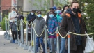 People lineup at a COVID-19 testing clinic Tuesday, May 11, 2021 in Montreal. THE CANADIAN PRESS/Ryan Remiorz