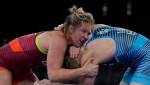 Canada's Erica Elizabeth Wiebe, left, and Estonia's Epp Maee compete during the women's 76kg Freestyle wrestling match at the 2020 Summer Olympics, Sunday, Aug. 1, 2021, in Chiba, Japan. (AP Photo/Aaron Favila)