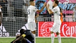 Inter Miami midfielder Victor Ulloa (13) and attacker Indiana Vassilev celebrate the team's win against CF Montreal in an MLS soccer match Saturday, July 31, 2021, in Fort Lauderdale, Fla. (AP Photo/Rhona Wise)