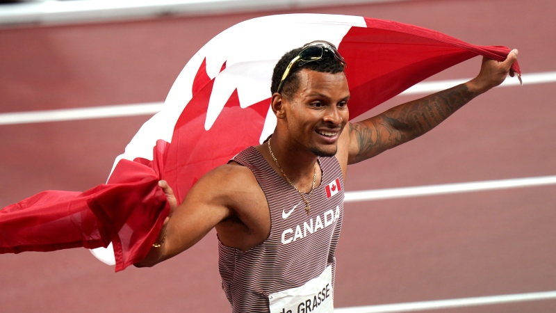 Andre De Grasse of Canada reacts after winning the bronze medal in the Men's 100m final during the summer Tokyo Olympics in Tokyo, Japan on Sunday, August 1, 2021. THE CANADIAN PRESS/Adrian Wyld