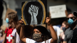 A young girl holds up a sign as she marches with hundreds of others during an Emancipation Day March, in Vancouver, on , August 1, 2020. Emancipation Day marks the abolition of slavery in parts of the British Empire. The Slavery Abolition Act went into effect on August 1, 1834, after receiving Royal Assent nearly a year earlier. THE CANADIAN PRESS/Darryl Dyck