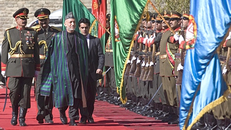 Afghan President Hamid Karzai, third left, inspects guard of honor during his inauguration as President of Afghanistan at the Presidential Palace in Kabul, Afghanistan, Thursday, Nov. 19, 2009. (AP / Musadeq Sadeq)