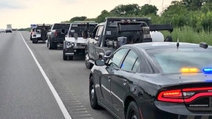 OPP say four tow trucks drivers are charged with street racing. (Courtesy: Twitter/OPP Highway Safety Division)