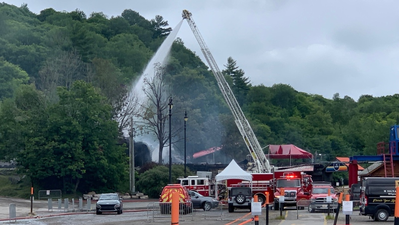 Fire crews at the scene of a fire at the main building at the Mont Cascades resort in Cantley, Que., Aug. 1, 2021. (Shaun Vardon / CTV News Ottawa)