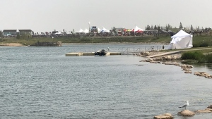 The victim of a drowning at Harmony Lake, a new community west of Calgary, was swimming in this weekend's Ironman 70.3 competition.