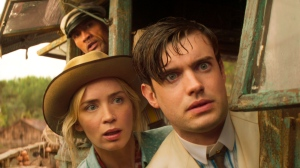 """This image released by Disney shows, from right, Jack Whitehall, Emily Blunt and Dwayne Johnson in a scene from """"Jungle Cruise."""" (Disney via AP)"""