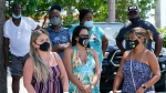 A group waits to get a COVID-19 test, Saturday, July 31, 2021, in North Miami, Fla. Federal health officials say Florida has reported 21,683 new cases of COVID-19, the state's highest one-day total since the start of the pandemic. (AP Photo/Marta Lavandier)